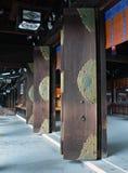 Temple doors open. Row of open doors in old japanese temple, Tokyo Stock Photography