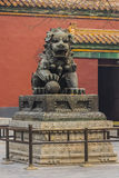 Temple dragon, or lion. Temple guard, dragon or lion, bronze statues, the male holds the earth, the female the child Royalty Free Stock Photography
