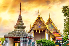 Temple of the Emerald Buddha (Wat Phra Kaew) in sunset time, Bangkok, Thailand. View of colorful rooftops of Temple of the Emerald Buddha (Wat Phra Kaew) in Stock Images