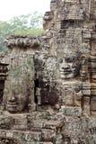 Temple en pierre de Bayon de découpages de visage Photographie stock libre de droits