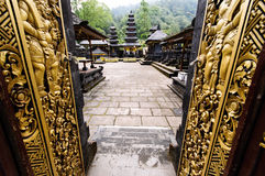 Temple entrance in Bali, Indonesia. Decorated golden doors in Bali, Indonesia Stock Photography