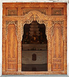 Temple entrance decorated with wooden carvings. Indonesia Stock Images