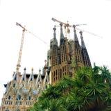 The Temple Expiatori de la Sagrada Família, trees and cranes in Barcelona city, Spain. The Temple Expiatori de la Sagrada Família is a large unfinished stock photo