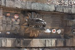 Temple of the Feathered Serpent. Wall detail in Teotihuacan pyramid complex. Close-up of a snake`s head stock images