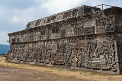 The Temple of the Feathered Serpent Xochicalco. The pre aztec Toltec Temple of the Feathered Serpent with its stylized depictions in Xochicalco, Mexico royalty free stock image
