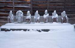 Temple figures in snow royalty free stock images