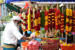 Temple florists prepare flowers and garlands for sale Royalty Free Stock Images