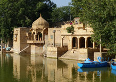 Temple at Gadsisar Tank, Jaisalmer. A man-made lake in Jaisalmer, once the setting for cremations and still surrounded by ghats and small temples Royalty Free Stock Photo