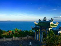 Temple gate. Bay sea landscape blue cloud day sea ocean green Stock Photo