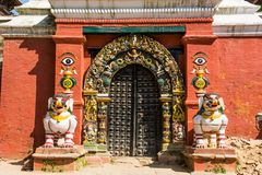 Temple gate guarded by deities. Royalty Free Stock Photos
