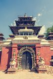 Temple gate guarded by deities. Royalty Free Stock Image
