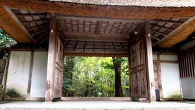Temple gate. Open to the garden, Kyoto, Japan royalty free stock photography