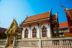 The temple with gold. A fragment of decoration on the roof. Khon Kaen.Thailand. Ancient Buddhist temples with gold in a small town in Thailand.Khon Kaen Stock Photography