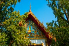 The temple with gold. A fragment of decoration on the roof. Khon Kaen.Thailand. Stock Image