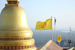 Temple golden dome, Thai Buddhist flag and aerial view to the coast Stock Image