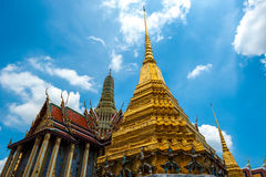 Temple and golden pagoda on blue sky at Wat Phra Kaew. Bangkok, Thailand Royalty Free Stock Photos