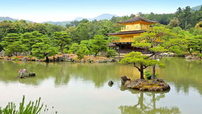 Temple of the Golden Pavilion Kinkaku-ji, Kyoto Japan. Zen Buddhist Temple of the Golden Pavilion Kinkaku-ji, officially named Rokuon-ji, Kyoto Japan stock video footage
