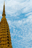 Temple Golden Top in front of beautiful blue and Royalty Free Stock Images