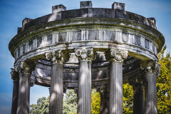 Temple, Greek-style columns, Corinthian capitals in a park Royalty Free Stock Images