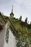 Temple with green mosaic. Part of Beautiful Wat Phra Kaeo temple with green mosaic gable in Thailand Royalty Free Stock Image
