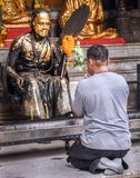 Doi Suthep temple-Man bows in front of Buddhist icon stock images