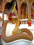 Temple guardian. A naga statue on fron of Thai temple Stock Image