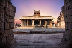 Temple in Hampi. Ancient temple with columns at violet sky in Hampi, Karnataka, India stock photography