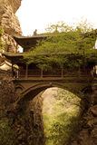Temple hanging over a deep chasm royalty free stock photos