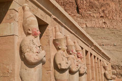 Temple of Hatshepsut. Painted statues at the Temple of Hatshepsut, Valley of the Kings, Luxor, Egypt Stock Photo