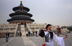 Temple of heaven in China. A Chinese model with a sword in front of the ancient Temple of Heaven in Beijing, China royalty free stock image
