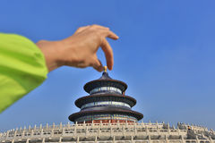 Temple of Heaven,people hand showing open the cap Royalty Free Stock Photography