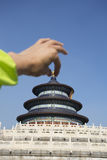 Temple of Heaven,people hand showing open the cap Royalty Free Stock Image