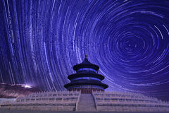 Temple of heaven with startrails as background Stock Photography