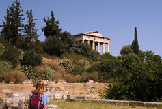 Temple of Hephaestus in Athens. A caucasian lady is looking at the temple of Hephaestus located on the hill in the Agora of Athens Stock Photo