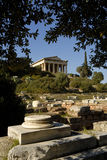 Temple of Hephaestus in Athens - Greece. Temple of Hephaestus in the ancient agora of Athens, in the park under the hill of the Acropolis, and with ruins at Stock Photo