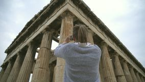 Temple of Hephaestus. Woman photographing Temple of Hephaestus in Athens, Greece stock video