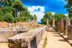 Temple of Hera. Olympia, Greece - September 7, 2014: Tourists are passing by Ruin of temple of Hera (Heraion) in Olympia, Greece on September 7, 2014 Royalty Free Stock Image