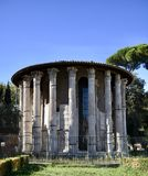 Temple of Hercules Victor. This is a Fall picture of the iconic Temple of Hercules Victor located in Piazza Bocca  della Verita in Rome, Italy.  This temple is a Royalty Free Stock Photo