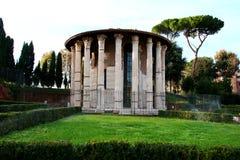 The Temple of Hercules Victor, Rome. The Temple of Hercules Victor ( Ercole Vincitore) in Piazza Bocca della verita, near church Santa Maria in Cosmedin, Rome Stock Images