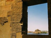 Temple hieroglyphs with Nile River View at Philae Stock Photo