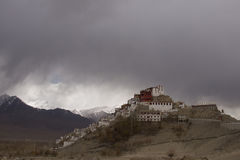 Temple on the hill in the background of mountains and rain clouds Stock Photos