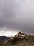 Temple on the hill in the background of mountains and rain clouds Stock Photo
