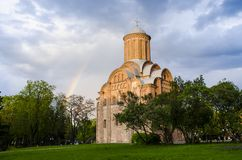 Temple of the Holy Mother Paraskevki Friday at the Torgovo Chernigov on the background of a blue, light rain with a rainbow sky. royalty free stock photography