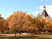 A temple in honor of the Holy Prince Alexander Nevsky in the autumn park. Victory Park, Saratov, Russia royalty free stock photos