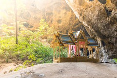 Temple of hope with warm light streaming in at this bhuddist shrine for the weary traveler inside the depths of a cave in Asia. royalty free stock photography