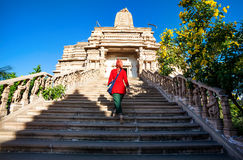 Temple in India. Indian woman in red dress on the stairs of Jain temple in Nasik, Maharashtra, India Stock Images