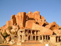 Temple infront of boulders. Indian temple ruin infront of massive rock boulders, hampi, india Stock Photo