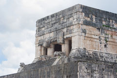 Temple of the jaguars Chichen Itza Yucatan Mexico. Upper part temple of the jaguars viewed from the great ball court Chichen Itza Yucatan Mexico Royalty Free Stock Photography