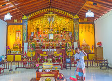 The Temple of Japanese Peace Pagoda. UNAWATUNA, SRI LANKA, DECEMBER 4, 2016: Interior of Japanese Peace Pagoda with numerous golden statues of Buddha and complex stock images