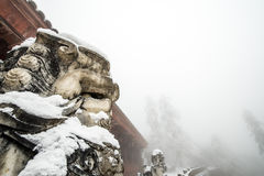A temple(jieyindian) covered with snow on the Emei Mountain Royalty Free Stock Images